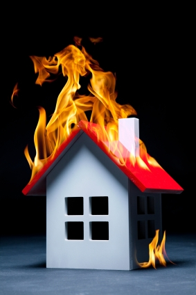 model of house on fire - Chicago Insurance lawyers